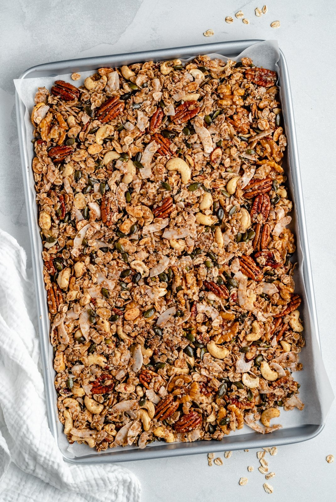 nut and seed granola on a baking sheet