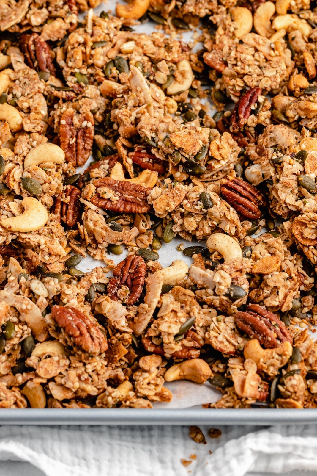 nut and seed granola on a baking pan