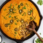 white chicken chili pie with pumpkin cornbread crust in a skillet