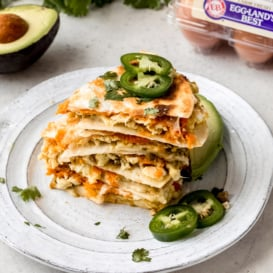 breakfast quesadillas in a stack on a plate
