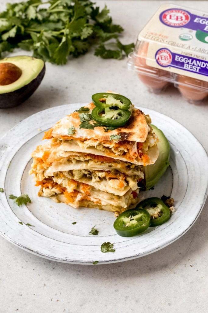 breakfast quesadillas in a stack on a plate