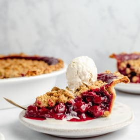 slice of tart cherry pie topped with ice cream