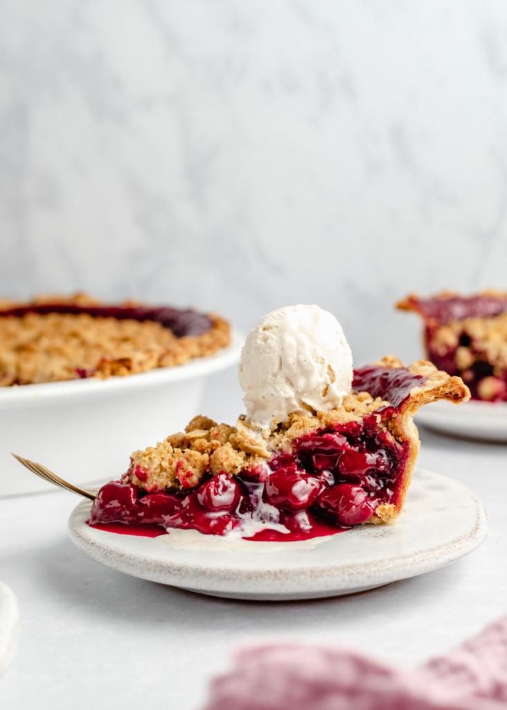 slice of tart cherry pie topped with ice cream