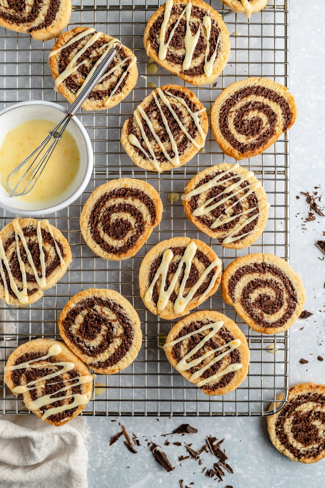 grain free orange chocolate pinwheels on a wire rack