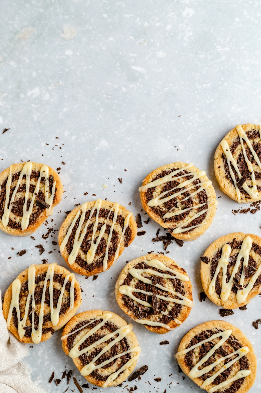 grain free chocolate orange pinwheel cookies drizzled with orange icing