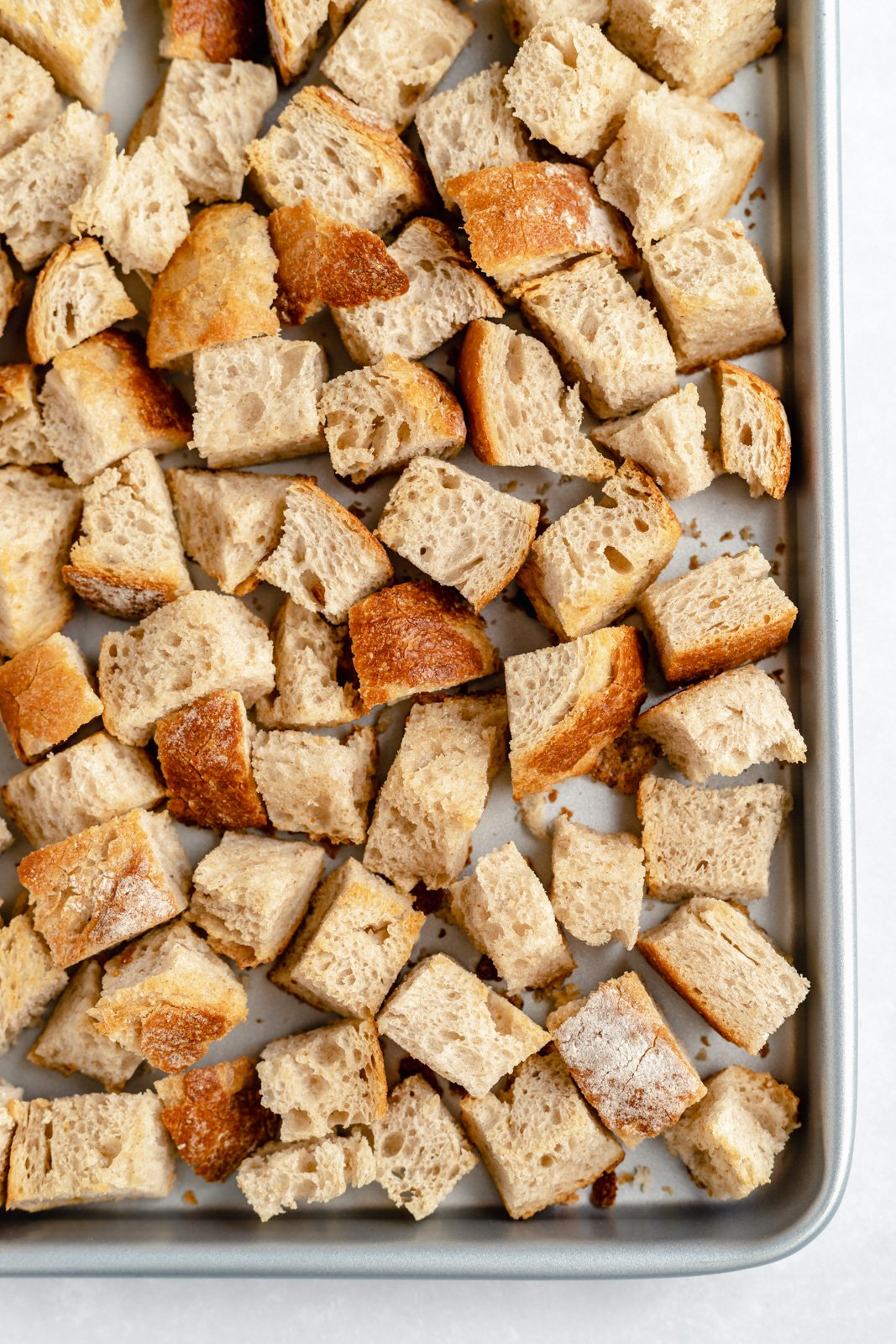 sourdough cubes on a baking sheet to make mushroom stuffing
