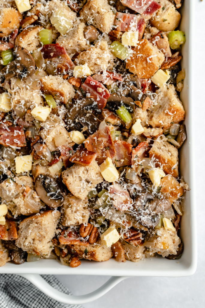 unbaked mushroom stuffing in a baking dish