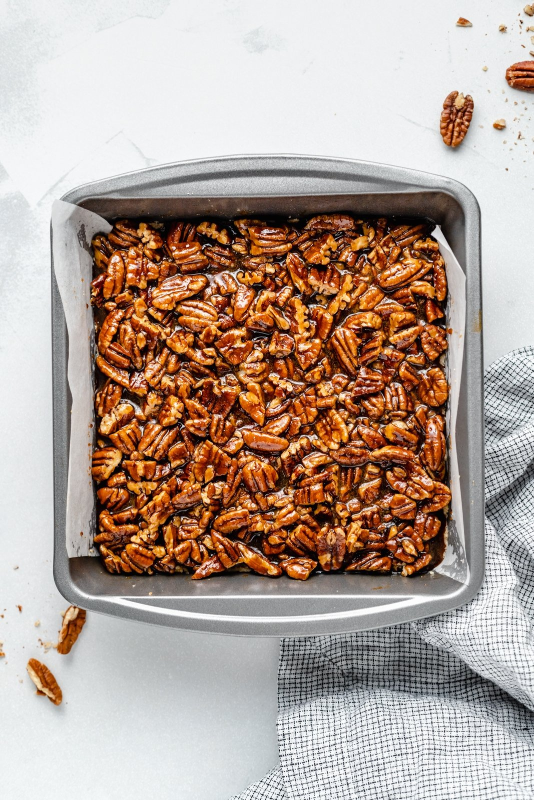 vegan pecan pie bars in a baking dish