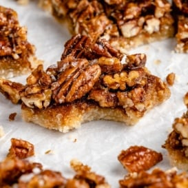 vegan pecan pie bar with a bite taken out