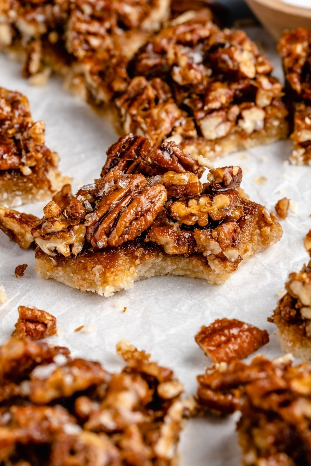 paleo pecan pie bar with a bite taken out