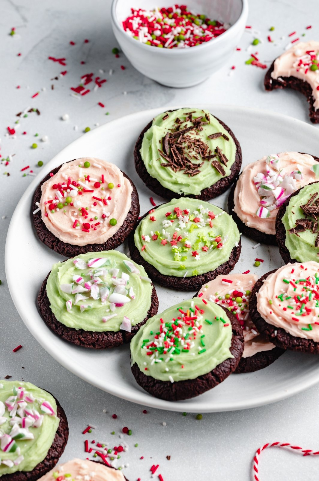 mint chocolate cookies with mint frosting on a plate