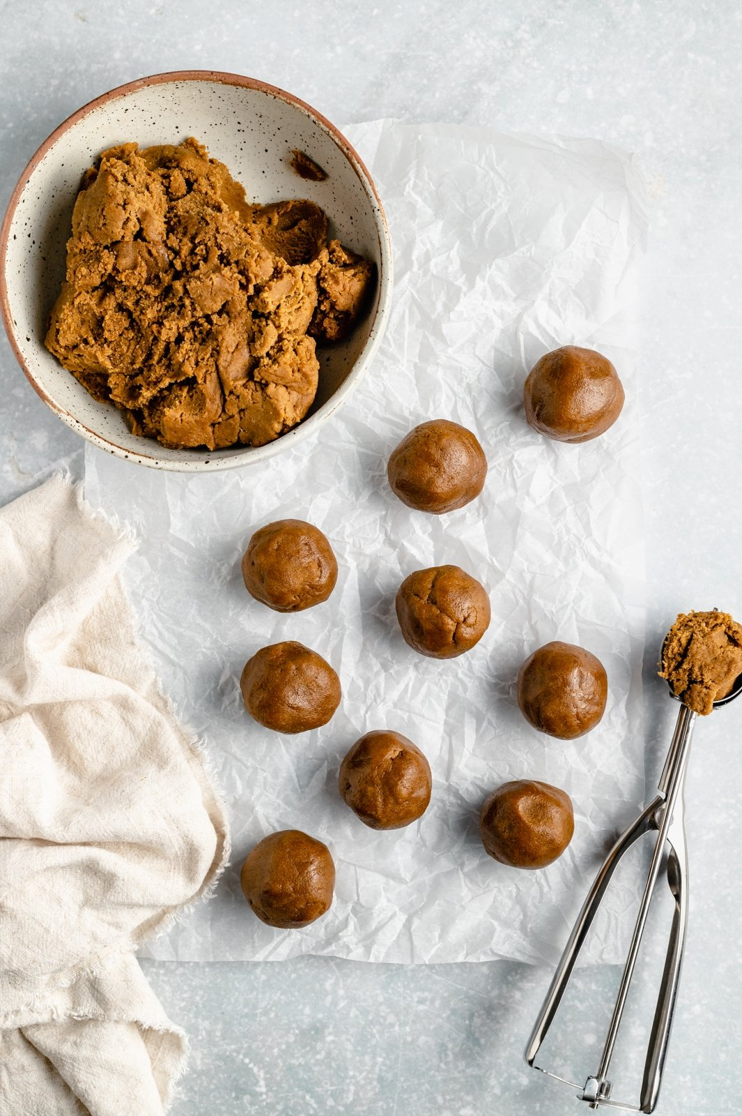 rolling soft ginger cookie dough into balls