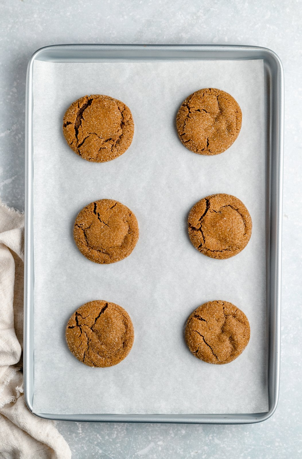 soft ginger cookies on a baking sheet