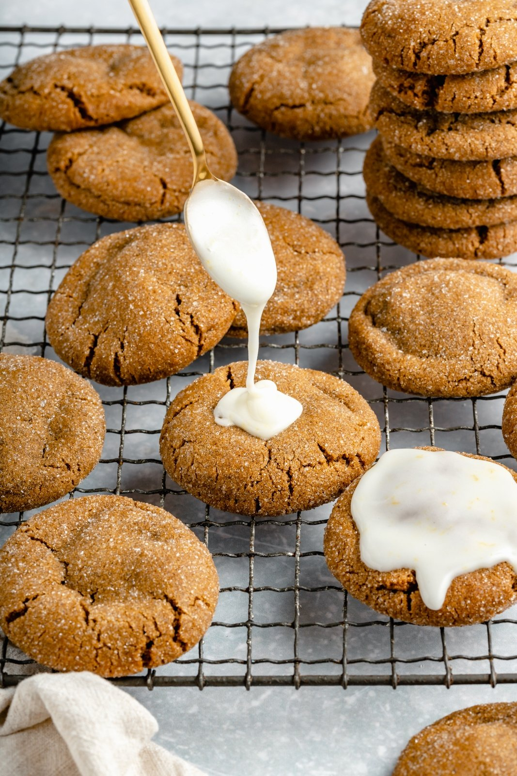 drizzling lemon icing on soft ginger cookies