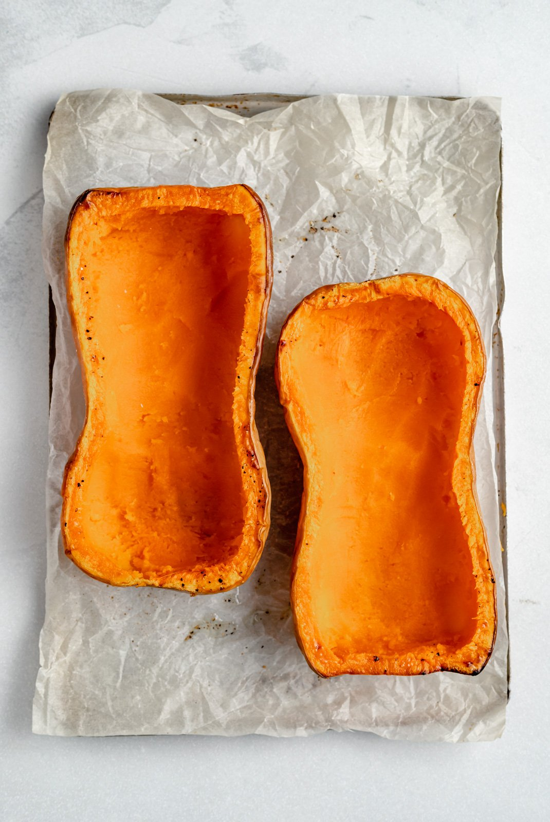 unbaked butternut squash on a baking tray
