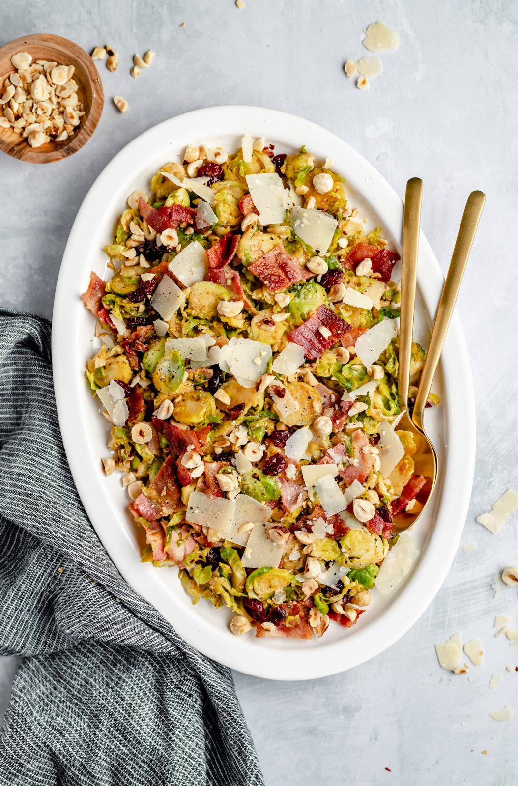 low carb warm brussels sprouts salad on a platter with serving utensils