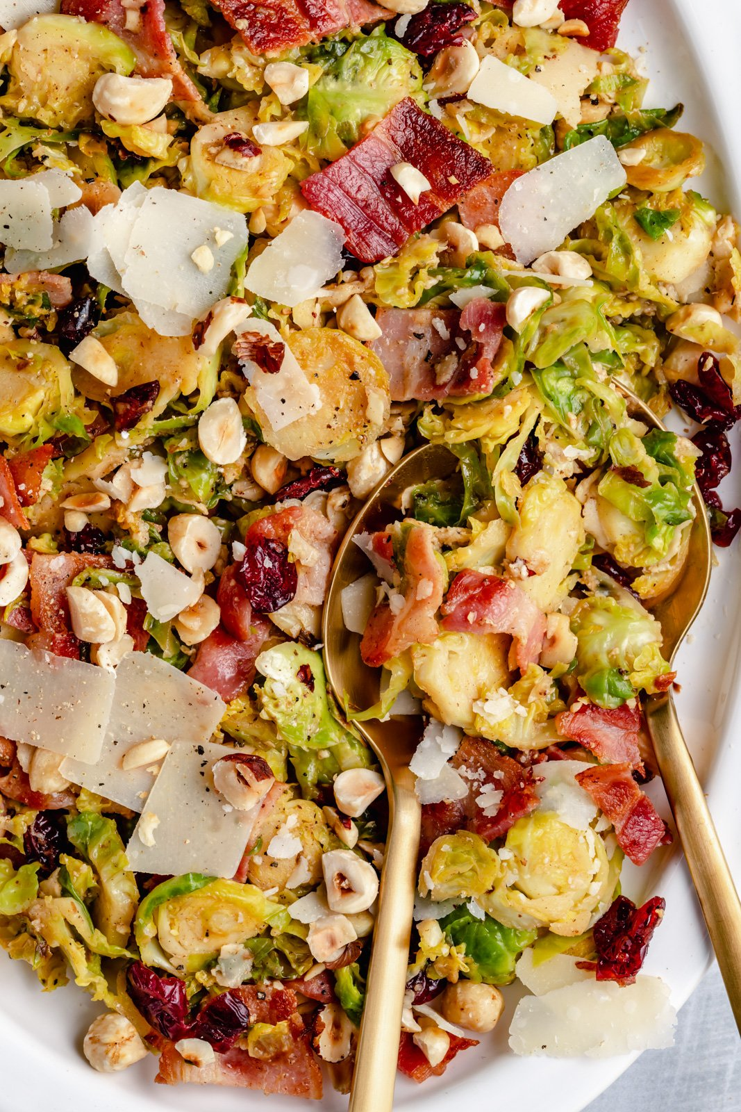 easy warm brussels sprouts salad with bacon on a serving tray