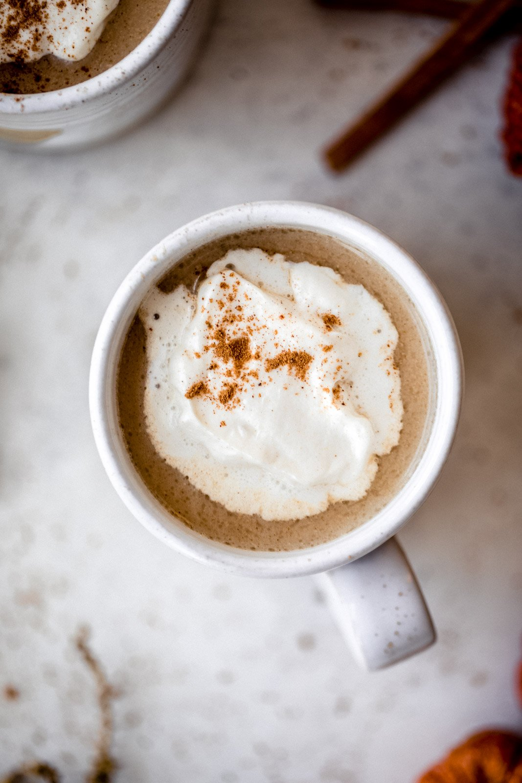 top-down view of a ginger latte with whipped cream