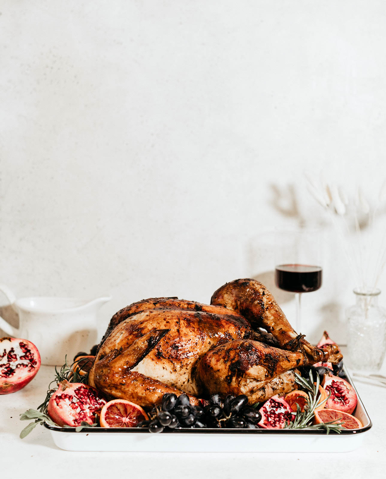 whole roasted turkey on a platter with fruit