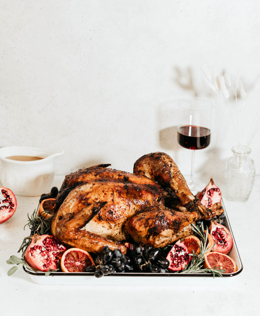 maple roasted turkey on a platter with fruit