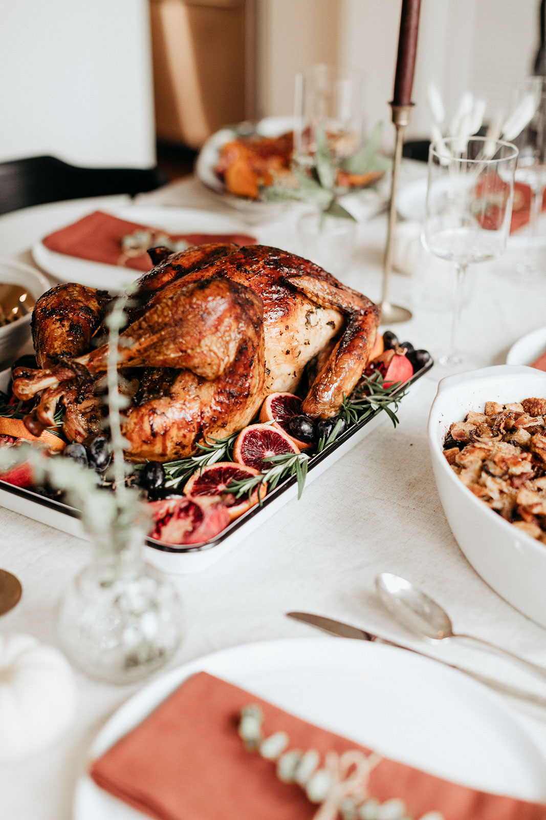 whole maple roasted turkey on a platter on a thanksgiving table