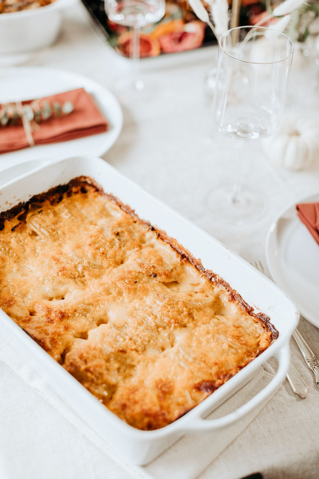 au gratin potatoes in a serving dish on a thanksgiving table