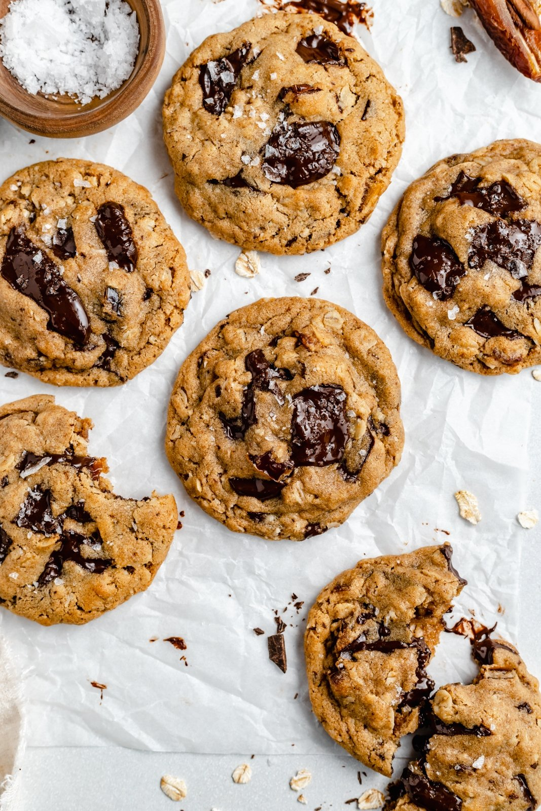 coffee tahini chocolate chunk oatmeal cookies on parchment paper