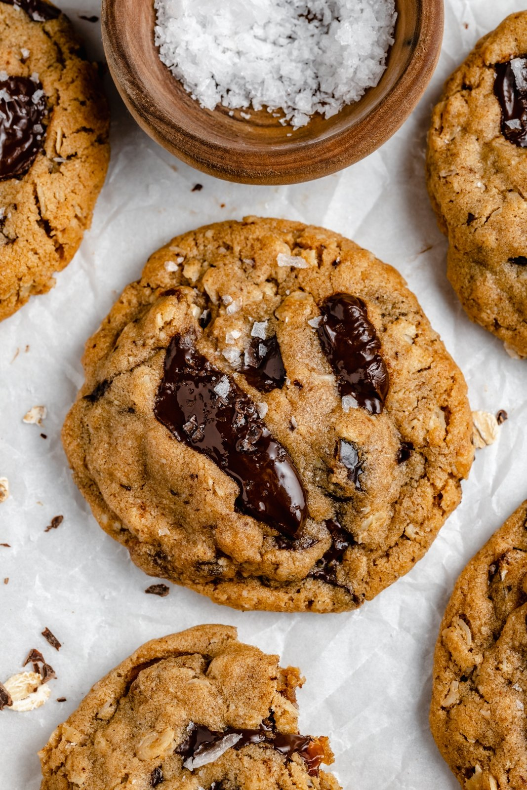 tahini chocolate chip oatmeal cookie on parchment paper