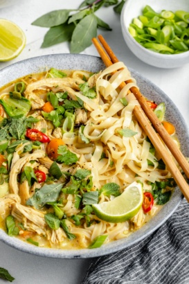 bowl of one pot curry chicken noodle soup with chopsticks