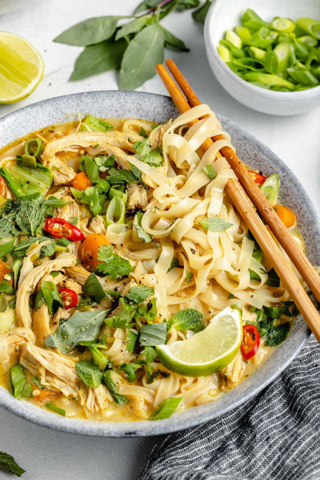 easy curry chicken noodle soup in a bowl with chopsticks