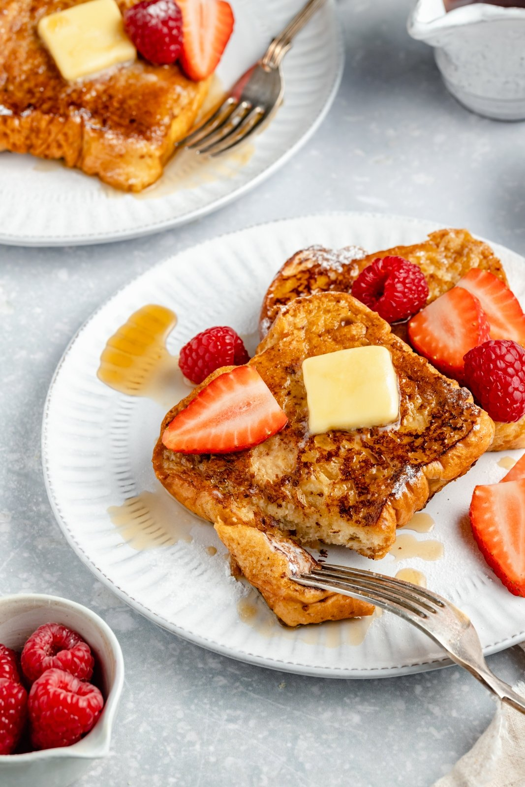 healthy french toast on plate with butter and berries