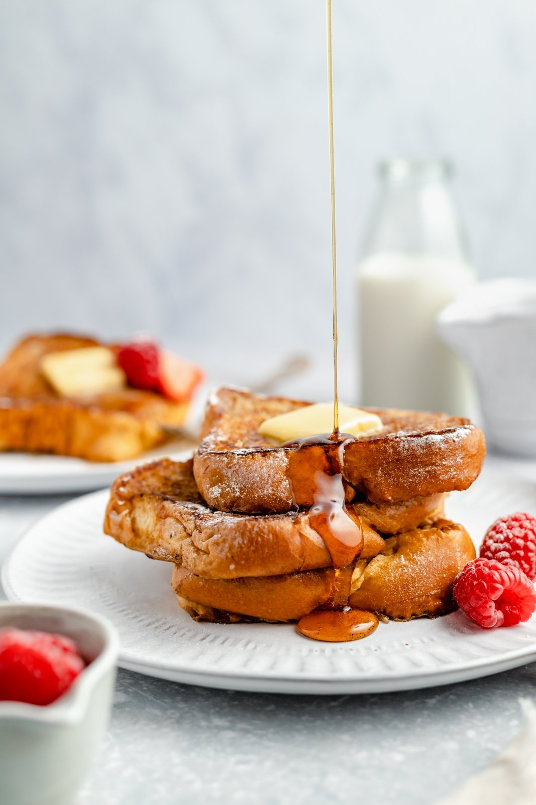 pouring syrup on a stack of dairy free french toast