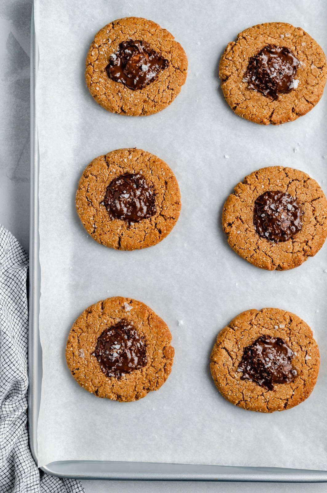 healthy peanut butter cup cookies on a baking sheet