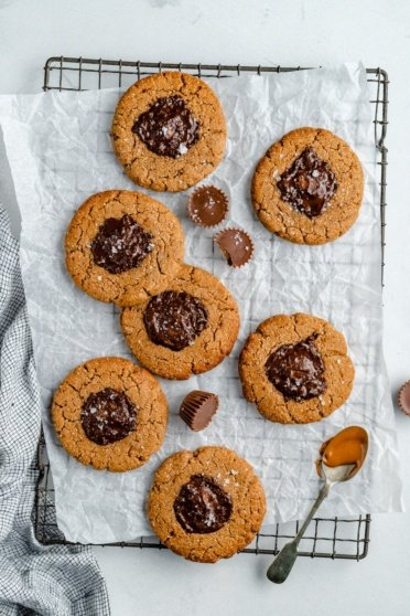 healthy peanut butter cup cookies on a wire rack