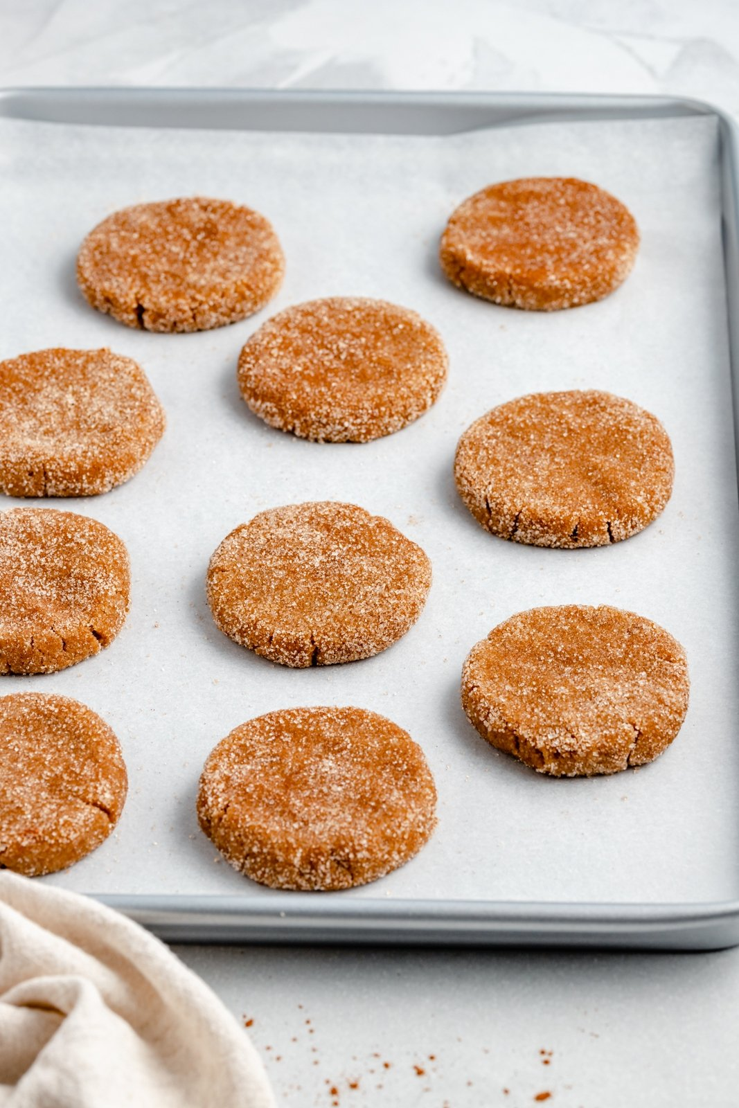 unbaked grain free snickerdoodles on a baking sheet