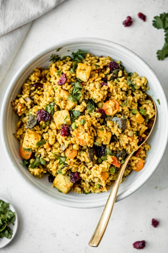 curried coconut brown rice with tofu in a bowl