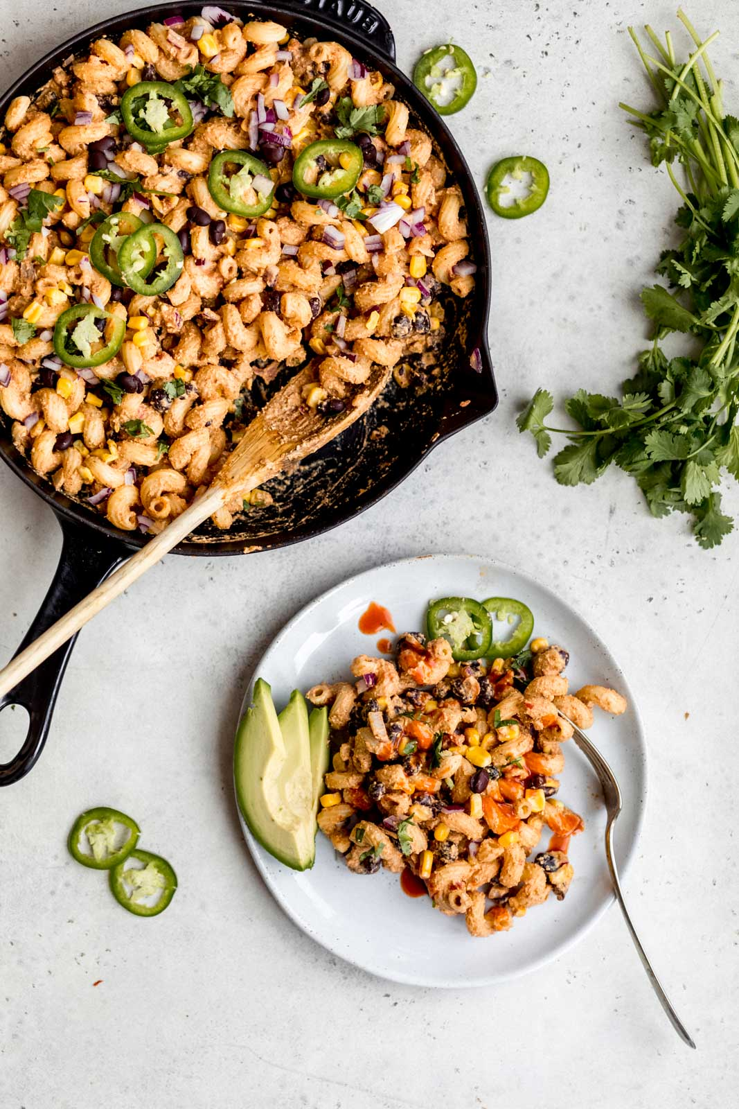 healthy vegan taco pasta on a plate and in a skillet