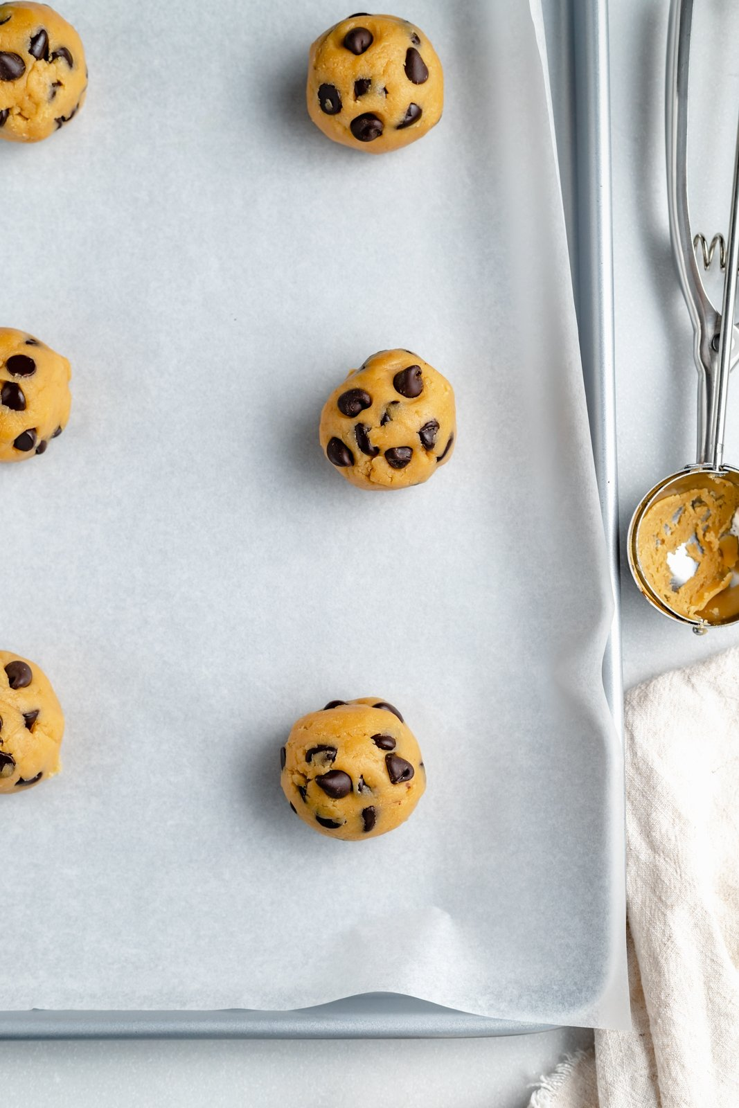 chickpea flour cookie dough balls on a baking tray