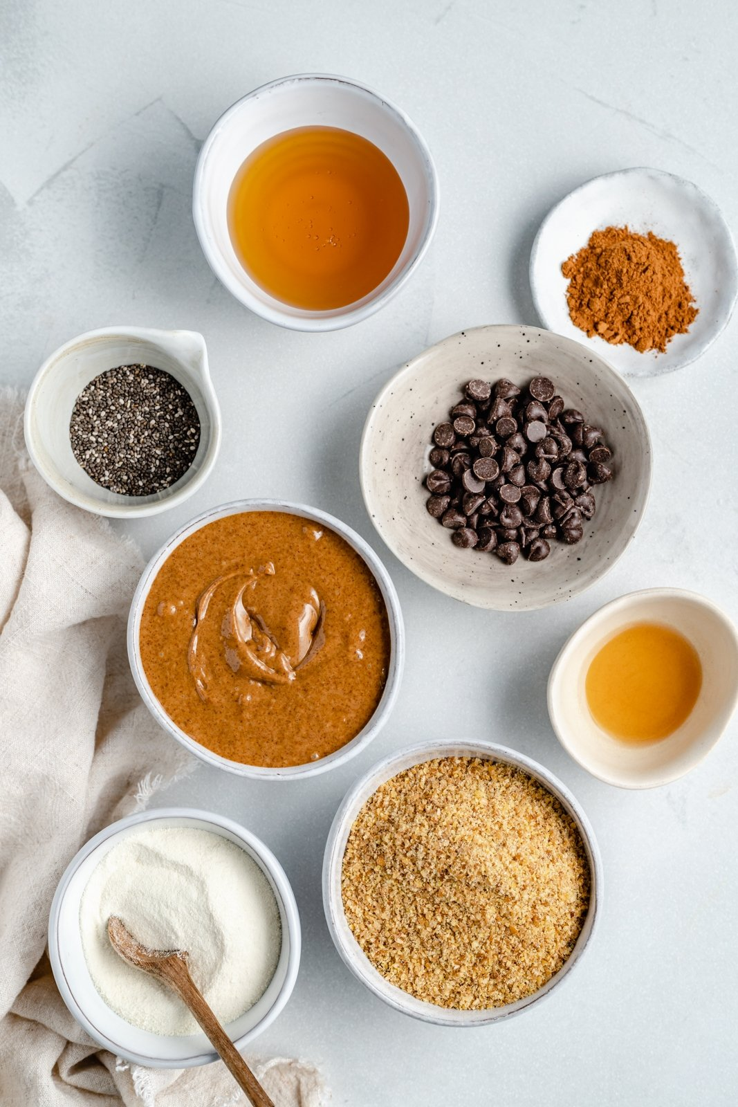 ingredients for almond butter energy balls in bowls