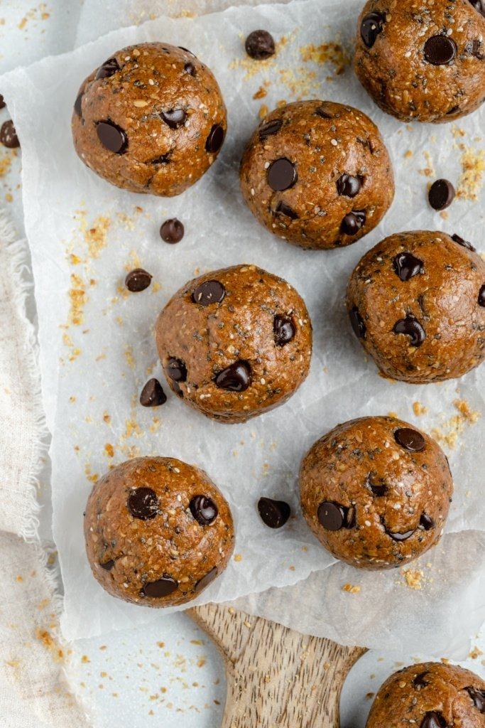 no bake almond butter energy bites with chocolate chips on parchment paper