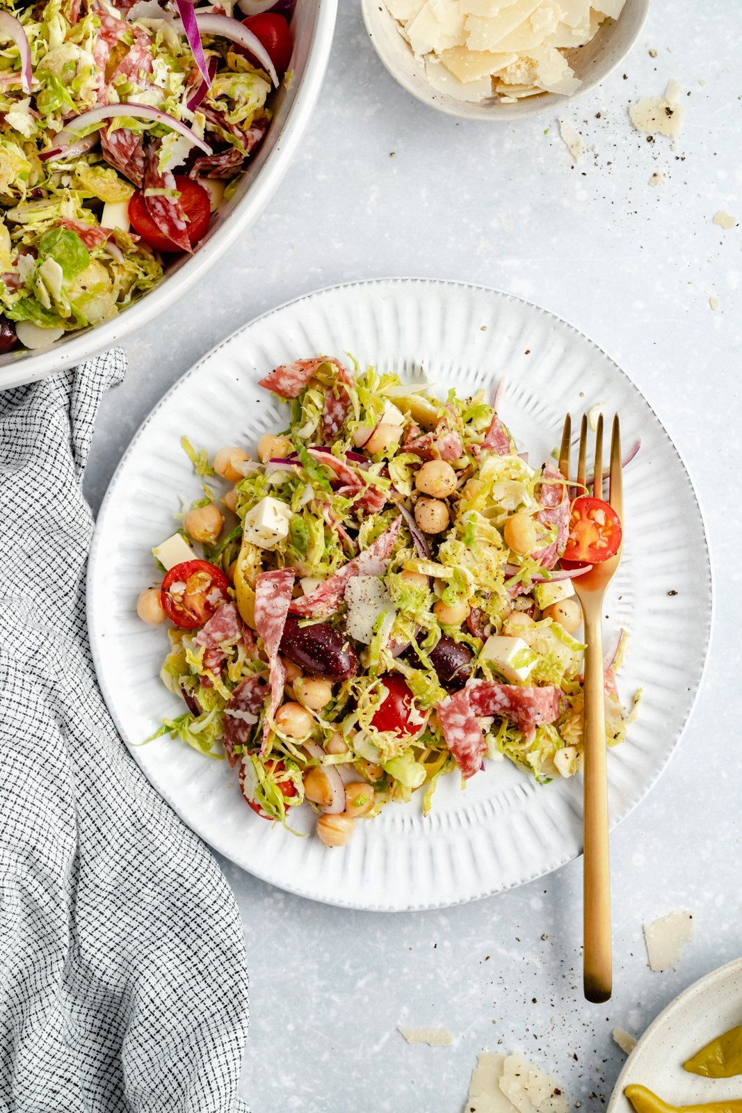 healthy italian chopped brussels sprouts salad on a plate with a fork