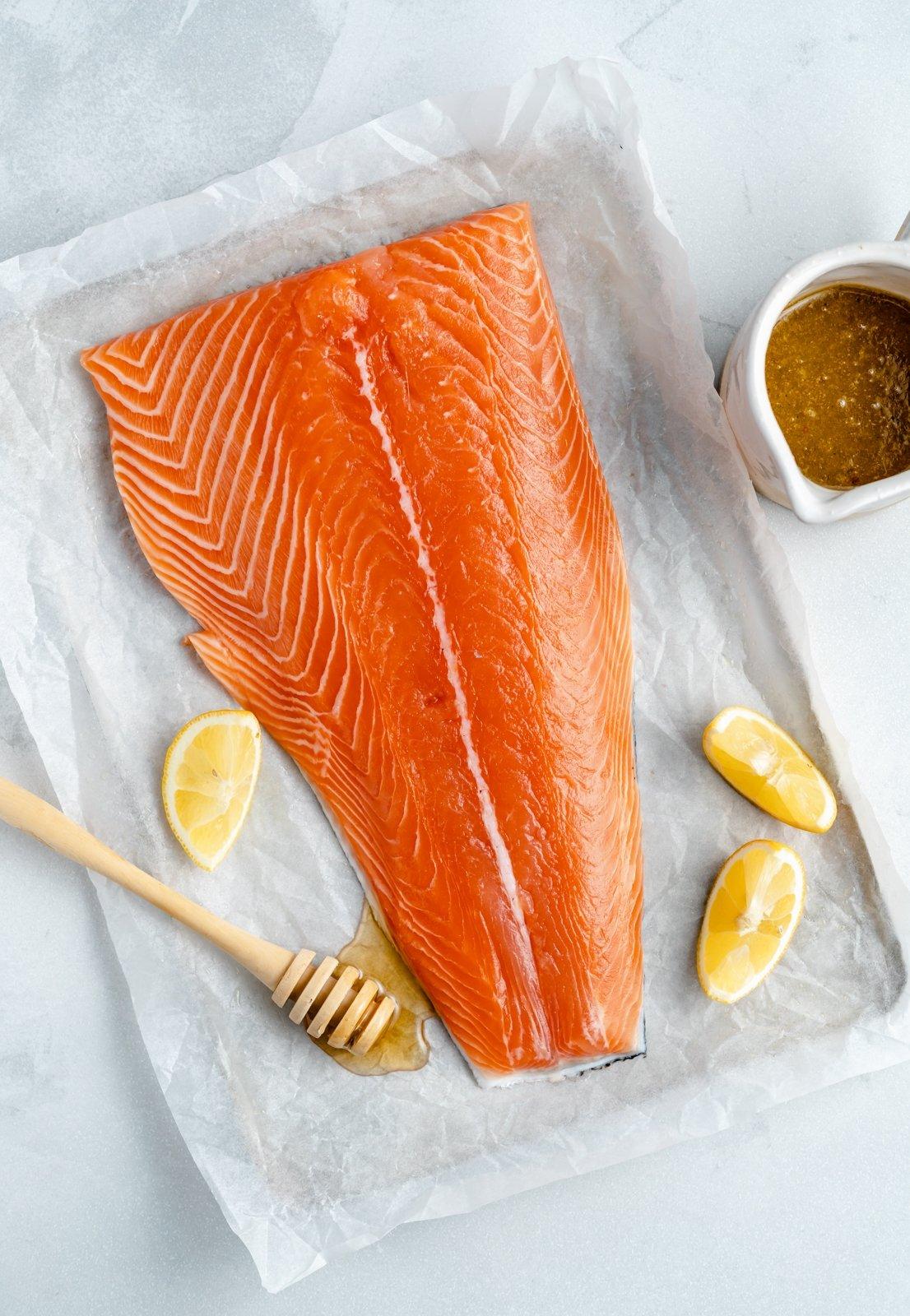 ingredients for lemon garlic salmon on a baking sheet