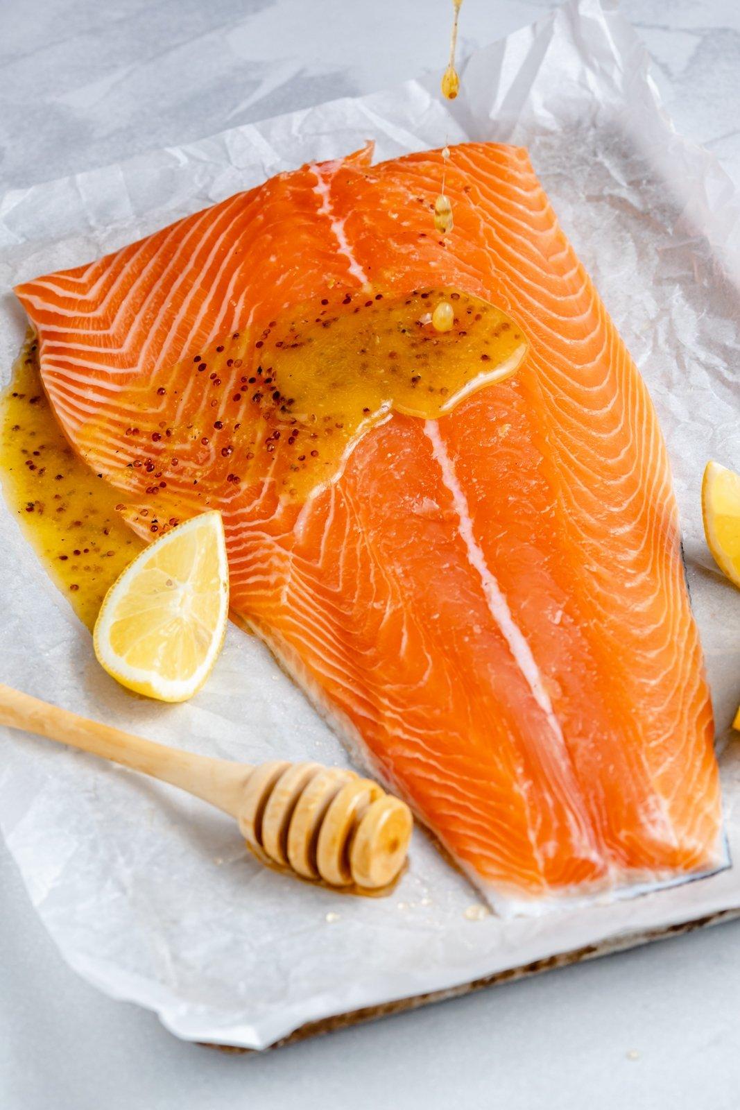easy lemon garlic salmon unbaked on a baking sheet
