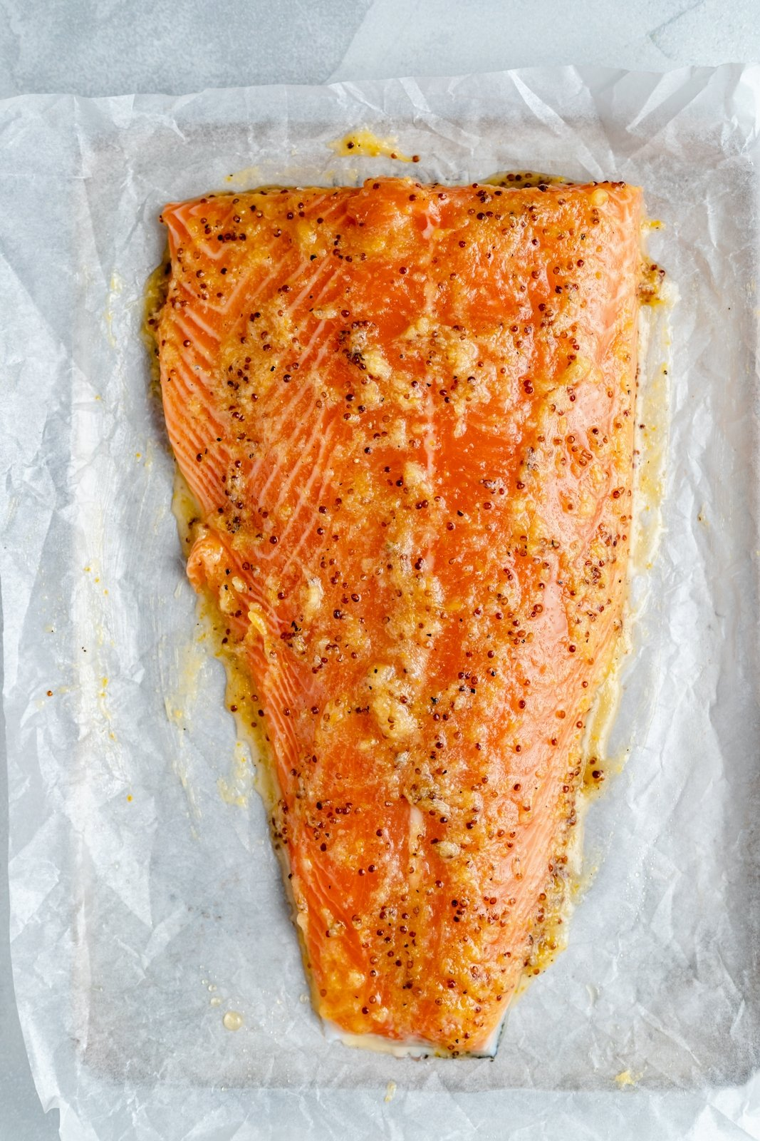 unbaked lemon garlic salmon on a baking sheet