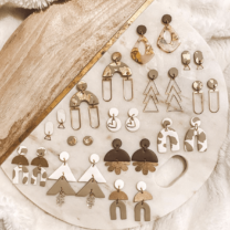 pairs of earrings on a round board