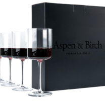 stemmed wine glasses next to a black box