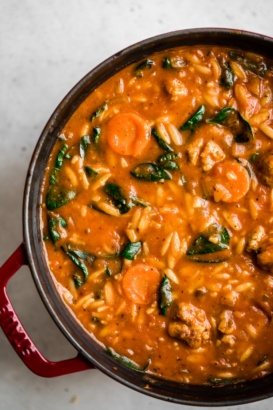 tomato orzo soup with turkey meatballs in a large pot
