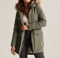woman wearing a green coat
