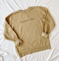 gold colored sweatshirt