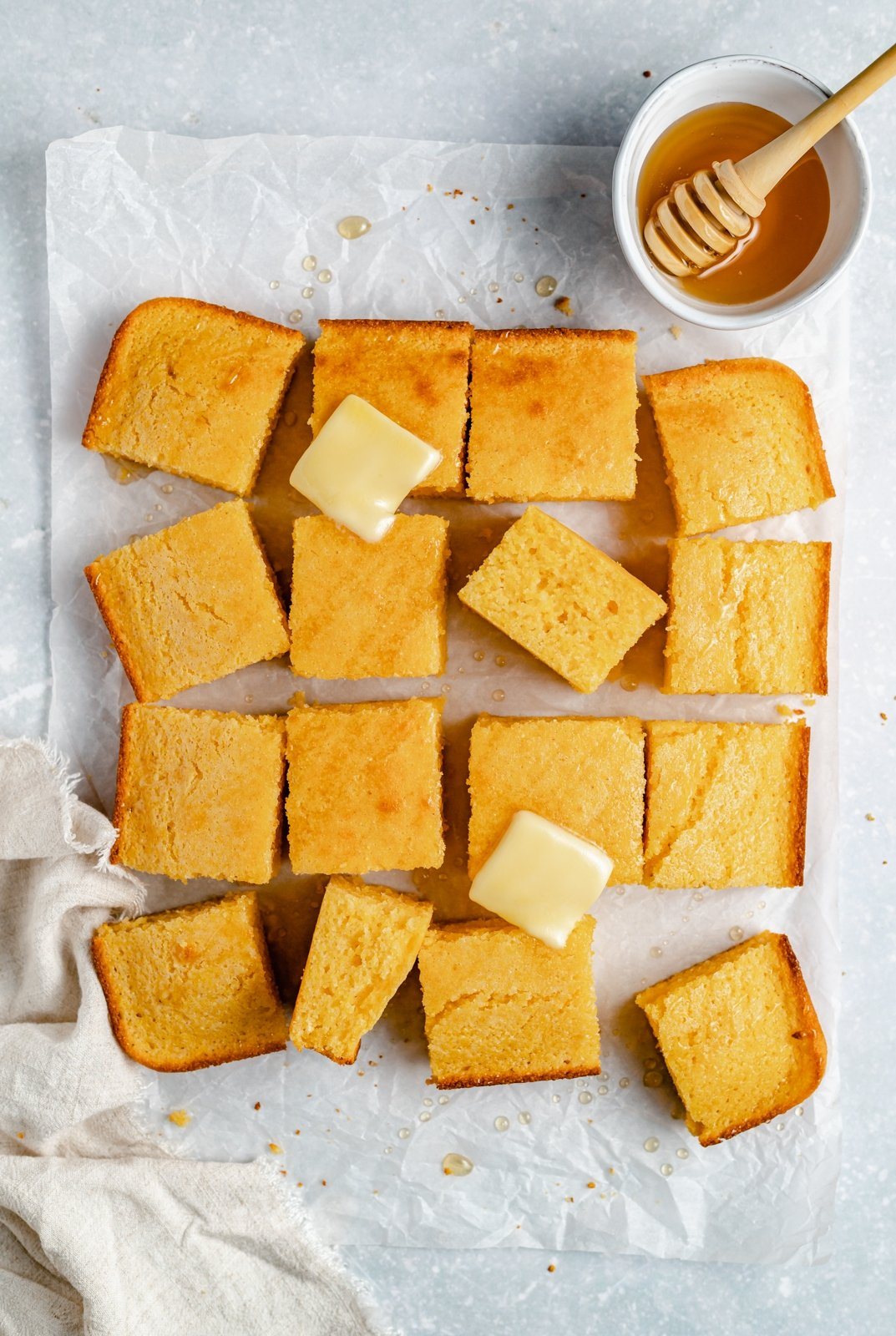 the best cornbread recipe topped with butter and cut into slices
